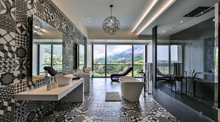 The washroom at Infinity House by GA Design at Khandala tries to optimise the outside view to connect with the nature